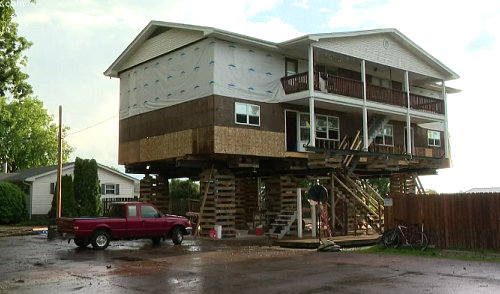 Homeowners in Portage Des Sioux lifting their properties after flooding